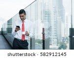 indian businessman drinking... | Shutterstock . vector #582912145