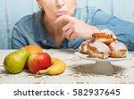 woman choosing between fruit... | Shutterstock . vector #582937645