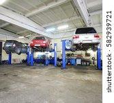 interior of a car repair garage | Shutterstock . vector #582939721