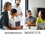 e com specialists team is... | Shutterstock . vector #582957175