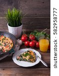 pan of frittata with spinach ... | Shutterstock . vector #582958777