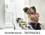 lesbian couple together indoors ... | Shutterstock . vector #582966361