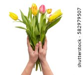 hands holding tuplis on the... | Shutterstock . vector #582979507