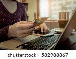 online payment woman's hands... | Shutterstock . vector #582988867