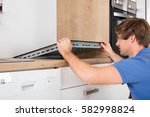 young man in overall installing ... | Shutterstock . vector #582998824
