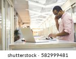 skilled male administrative... | Shutterstock . vector #582999481