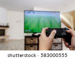man playing video game. hands... | Shutterstock . vector #583000555