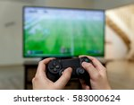 Man Playing Video Game. Hands...