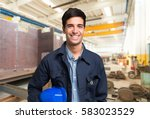 smiling mechanical worker... | Shutterstock . vector #583023529