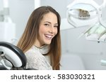 satisfied dentist patient... | Shutterstock . vector #583030321