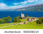 Urquhart Castle along Loch Ness lake in Scotland in a beautiful summer day, United Kingdom