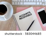 Small photo of Business concept - Top view notebook writing Account Receivable