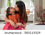 pretty indian woman kissing her ... | Shutterstock . vector #583115329