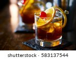 tasty alcoholic old fashioned... | Shutterstock . vector #583137544