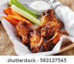 bbq buffalo chicken wings in... | Shutterstock . vector #583137565