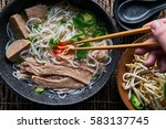 eating pho with brisket and... | Shutterstock . vector #583137745