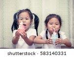 two asian little girl having... | Shutterstock . vector #583140331