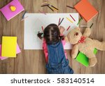 little asian girl drawing with... | Shutterstock . vector #583140514