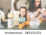bottle with milk and manual... | Shutterstock . vector #583151251