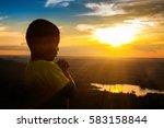 boy praying on the mount  thank ... | Shutterstock . vector #583158844