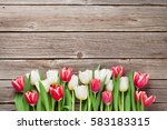 Colorful Tulips On Wooden...