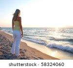 girl on beach in sunset | Shutterstock . vector #58324060