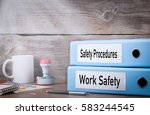 Small photo of Work Safety and Safety Procedures. Two binders on desk in the office. Business background
