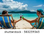 couple in loungers clinking... | Shutterstock . vector #583259365