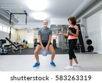 senior man in gym working out... | Shutterstock . vector #583263319