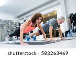 senior couple in gym working... | Shutterstock . vector #583263469