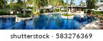 swimming pool in the tropics | Shutterstock . vector #583276369