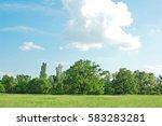 spring oak tree in green meadow ... | Shutterstock . vector #583283281