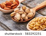 tasty and healthy nuts in a... | Shutterstock . vector #583292251