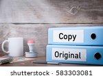 original and copy. two binders... | Shutterstock . vector #583303081