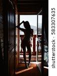 silhouette girl at the door on... | Shutterstock . vector #583307635