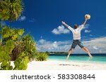 happy man jumping on the... | Shutterstock . vector #583308844