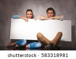 smiling young couple is sitting ... | Shutterstock . vector #583318981