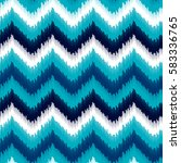 Ethnic blue and white ikat abstract geometric chevron seamless pattern, vector background | Shutterstock vector #583336765