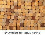 wood log pile background | Shutterstock . vector #583375441