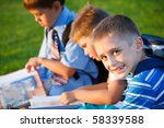 kids with books sitting in park | Shutterstock . vector #58339588