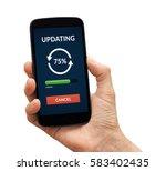 hand holding a black smart... | Shutterstock . vector #583402435