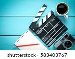 clapper movie with blank note... | Shutterstock . vector #583403767