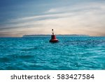 A Red Buoy Floats In The Middle ...