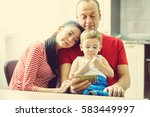 family watching a cartoon on a... | Shutterstock . vector #583449997