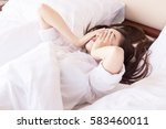 young woman can not sleep. on... | Shutterstock . vector #583460011