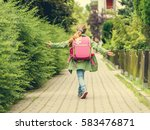 little girl with a backpack... | Shutterstock . vector #583476871