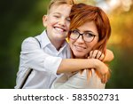 happy mother with her son... | Shutterstock . vector #583502731