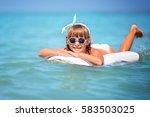 cute little girl is swimming in ... | Shutterstock . vector #583503025