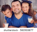 father with children are... | Shutterstock . vector #583503877