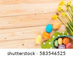 happy easter  narcissus flowers ...   Shutterstock . vector #583546525